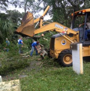 Public Works with backhoe